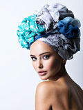 Sexy portrait of a beautiful girl with turban on head. Stock Photography