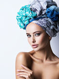 Sexy portrait of a beautiful girl with turban on head. Stock Image