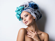 Sexy portrait of a beautiful girl with turban on head. Royalty Free Stock Photography