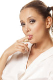 Portrait. Girl in white shirt sucking her finger royalty free stock photo
