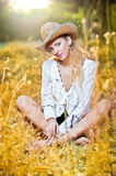 portrait woman with hat and white shirt Stock Photo