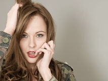 Portrait Of A Woman Wearing an Army or Military Camouflage royalty free stock image
