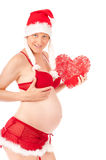 Sexy pregnant woman as Santa Claus Stock Photography