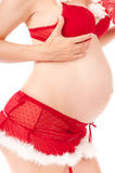 Sexy pregnant woman as Santa Claus Stock Photo