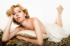 Sexy pretty woman  lying on a sofa Stock Images