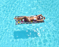 Sexy pretty woman relaxing in a swimming pool leisure Stock Photography
