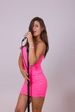 Sexy pretty woman singing on microphone Royalty Free Stock Photos