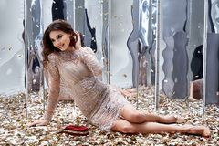Sexy pretty woman sit floor with lot of golden sequins glamour f. Ashion model bright makeup perfume wear lace stylish dress celebration party holiday beauty Royalty Free Stock Images
