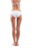 Sexy Rückseite einer jungen Frau in einem weißen Badeanzug Lizenzfreies Stockbild