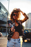 Sexy rebel girl showing middle finger. While standing in the street Royalty Free Stock Photo