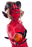 Sexy red devil woman holding an apple Royalty Free Stock Image