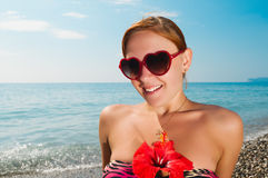 Sexy red girl wearing bikini at the beach Royalty Free Stock Image