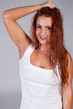 Sexy red hair woman in wet white t shirt Royalty Free Stock Photos