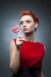 Sexy red-haired girl holding candy Stock Photography