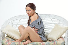 Sexy red-haired woman wearing only a men's shirt Royalty Free Stock Photography