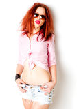 Sexy red haired woman, wild attitude posing in the studio Stock Photos