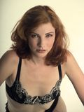 Sexy red head in black lingerie Royalty Free Stock Photography