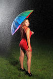 Sexy Red Head Woman with Umbrella Royalty Free Stock Photos