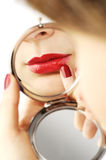 Sexy red lips with hand hand mirror Royalty Free Stock Photography