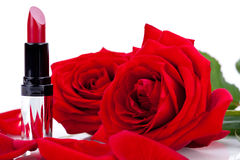 red or scarlet lipstick with roses Royalty Free Stock Photo