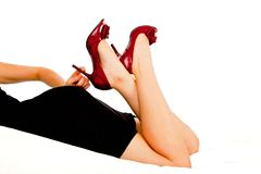 Sexy Red shoes. Sexy lady wearing black dress and red heels Royalty Free Stock Photos