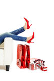 Red Shoes. Female legs with red shoes over christmas presents stock photography