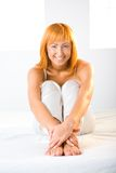 Sexy redhead on bed Royalty Free Stock Photo