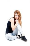 Sexy redhead on the floor looking at camera Royalty Free Stock Photos