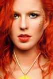 redhead girl with an unusual makeup and a nec royalty free stock photos