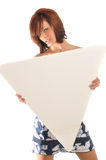 Sexy redhead holding blank sign Stock Photo