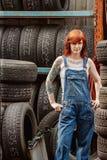 redhead mechanic with tattoos stock photos