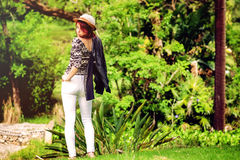 Redhead in the park. A redhead is having fun in the in the park is smiling. The image has been filtered stock photo