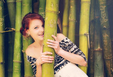 Redhead in the park. A redhead is having fun in the in the park is smiling. The image has been filtered stock image