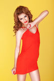 Sexy Redhead In Short Red Dress Royalty Free Stock Photo