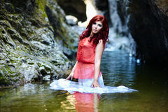 Sexy redhead standing in water Royalty Free Stock Photo