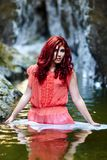 Sexy redhead standing in water Royalty Free Stock Image