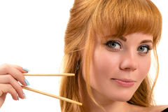 Sexy redhead woman with chopsticks Royalty Free Stock Photo
