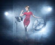 A sexy redhead woman posing on a fashion photoshoot Stock Photos