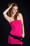 Sexy redhead woman posing to the camera Stock Photography