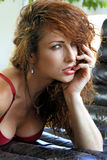 Sexy redhead woman. Provocative red-haired woman in a seductive pose Stock Photography