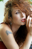 Sexy redhead woman. Provocative red-haired woman in a seductive pose Royalty Free Stock Image