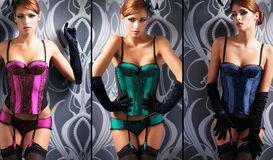Sexy redhead women in erotic corsets Royalty Free Stock Images