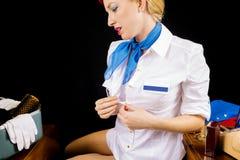 Sexy Retro Stewardess Undressing or Dressing Stock Image