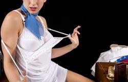Sexy Retro Stewardess Undressing or Dressing Stock Photo