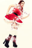 Retro Young Woman Tangled in Christmas Lights Stock Photo