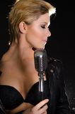 Sexy rocksinger with microphone Stock Photo