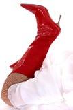 Sexy rode hoge hiellaarzen Stock Afbeeldingen