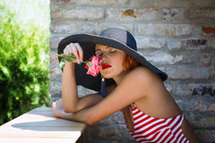 Sexy romantic woman in hat smell flower Royalty Free Stock Image