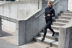 Sexy runner in jogging suit Royalty Free Stock Photo