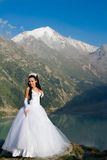 Sexy russian  girl the bride in a wedding dress Royalty Free Stock Image